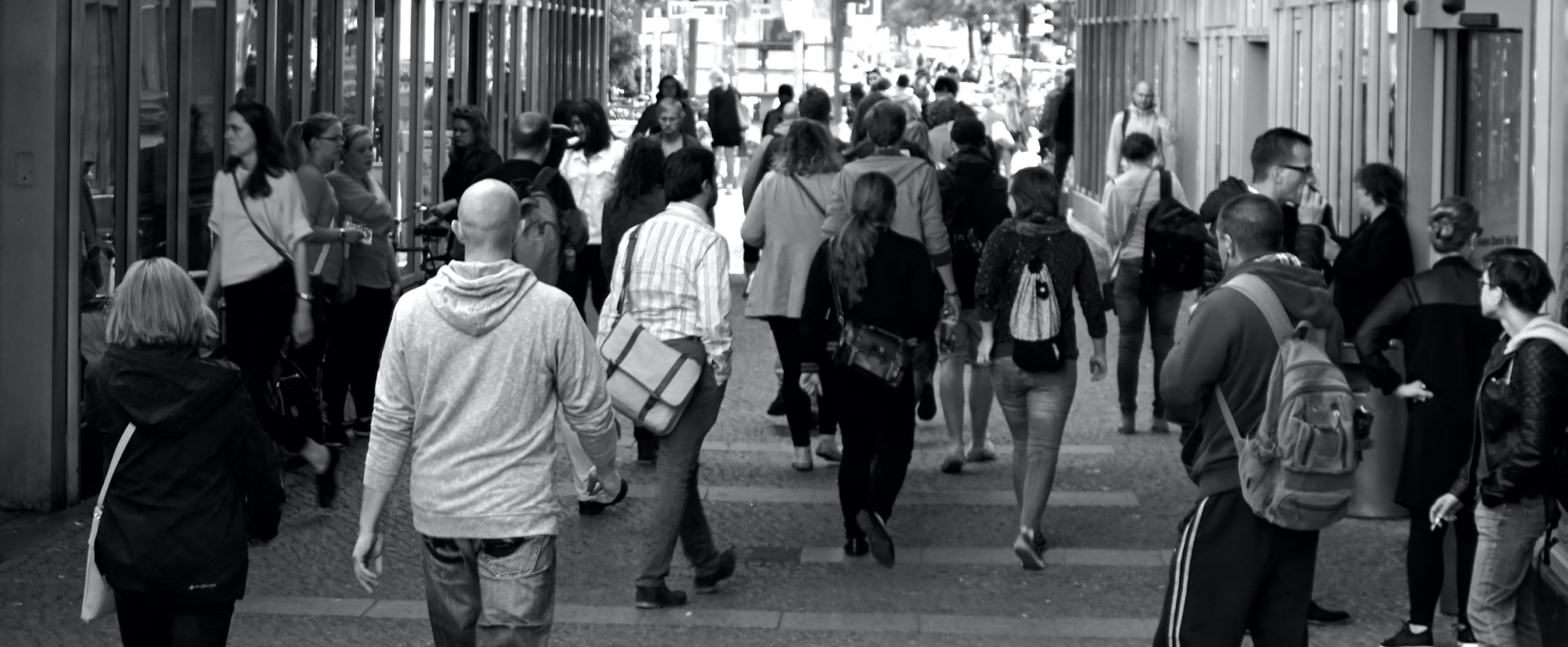 Canva - Grayscale Photography of People Walking Near Buildings